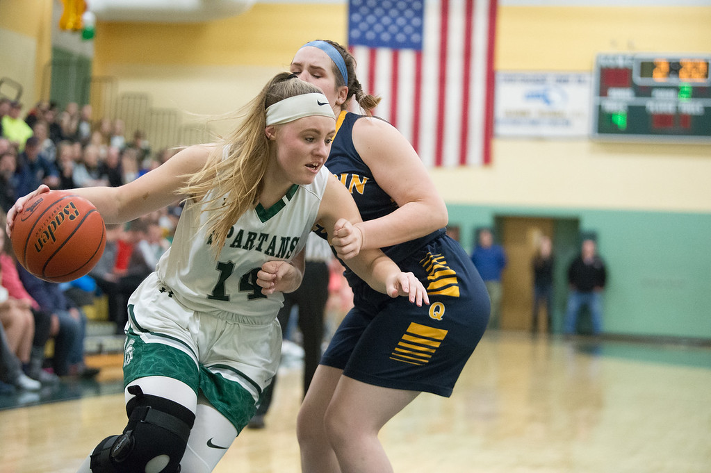 . 11819 OAKMONT-  Oakmont senior captain Leah Pelkey (14) carries the ball around Quabbin senior Emma Lockwood in Friday\'s game at home against Quabbin.  SENTINEL & ENTERPRISE JEFF PORTER