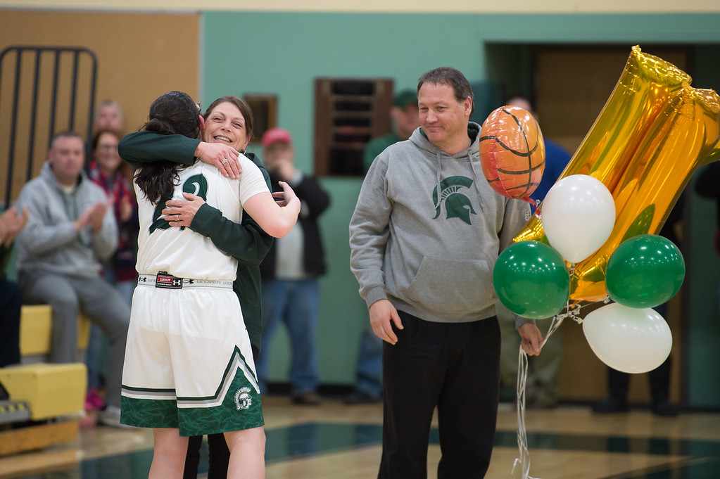. 11819 OAKMONT-  Oakmont senior captain Kylie Lison celebrates her 1000th high school career point with family and freinds in Friday\'s game at home against Quabbin.  SENTINEL & ENTERPRISE JEFF PORTER