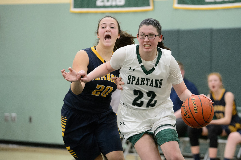 . 11819 OAKMONT-  Oakmont senior captain Kylie Lison (22) runs the ball around Quabbin junior Olivia Giorgi in Friday\'s game at home against Quabbin.  SENTINEL & ENTERPRISE JEFF PORTER