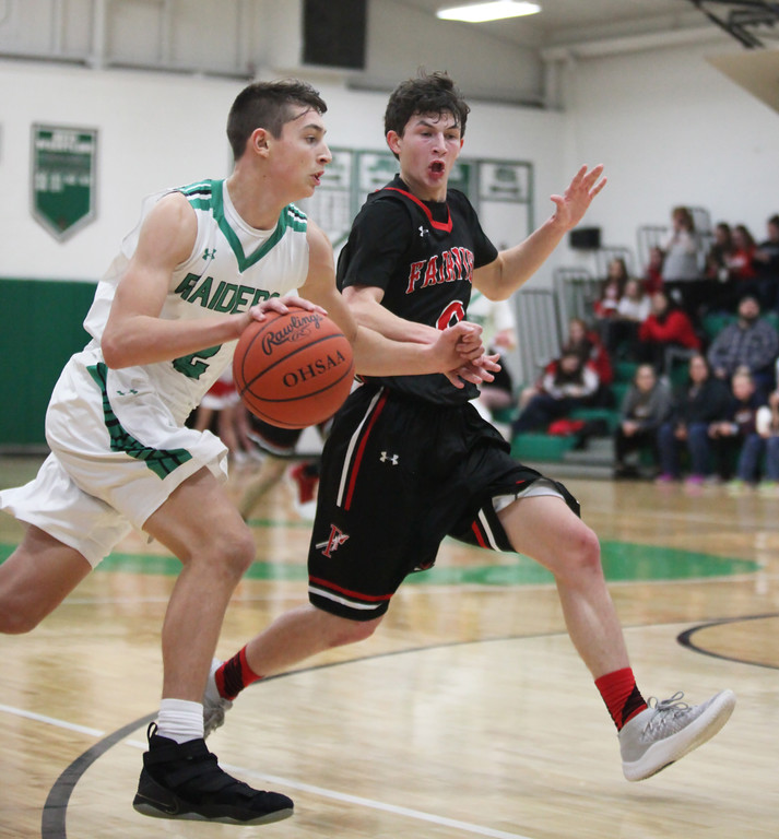 . Columbia\'s Adam Ross drives by Owen Morrison of Fairview during the second quarter. Randy Meyers -- The Morning Journal