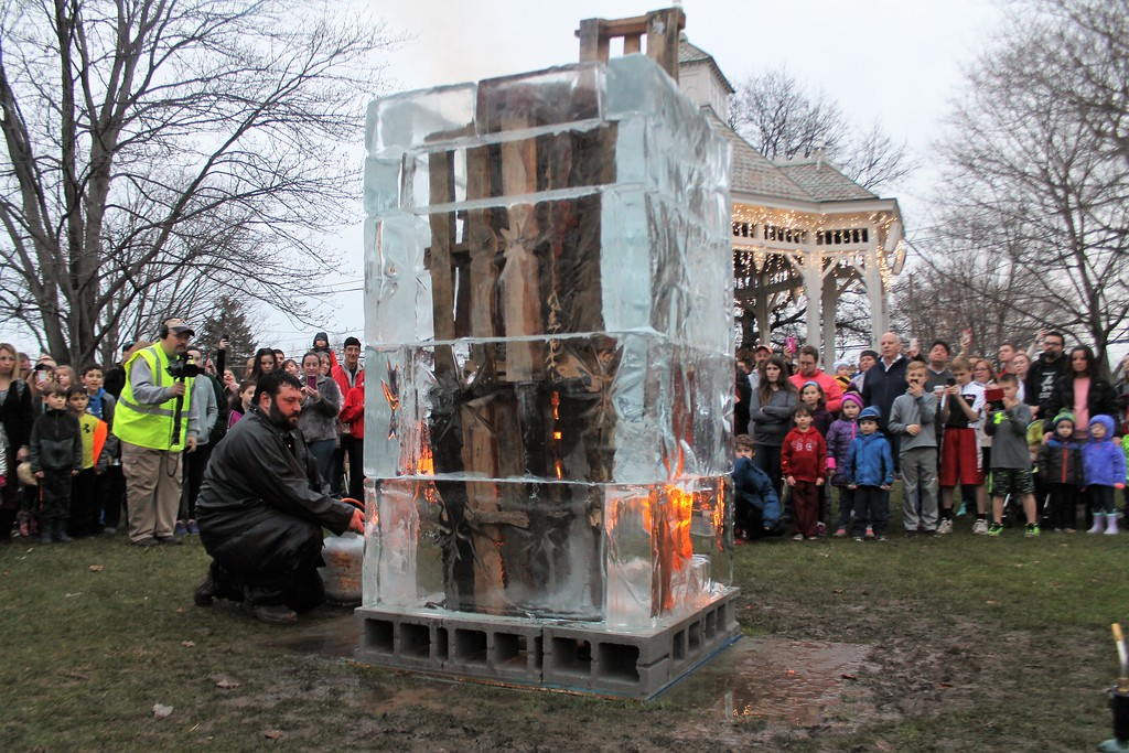 . Jeff Meyers of Elegant Ice, lights ice tire on fire. (Kristi Garabrandt/The News-Herald)
