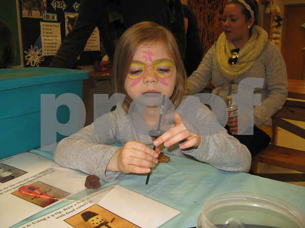 Jade Kufalk, 5, of Belvidere makes a tasty snowman kabob Saturday at Winterfest.