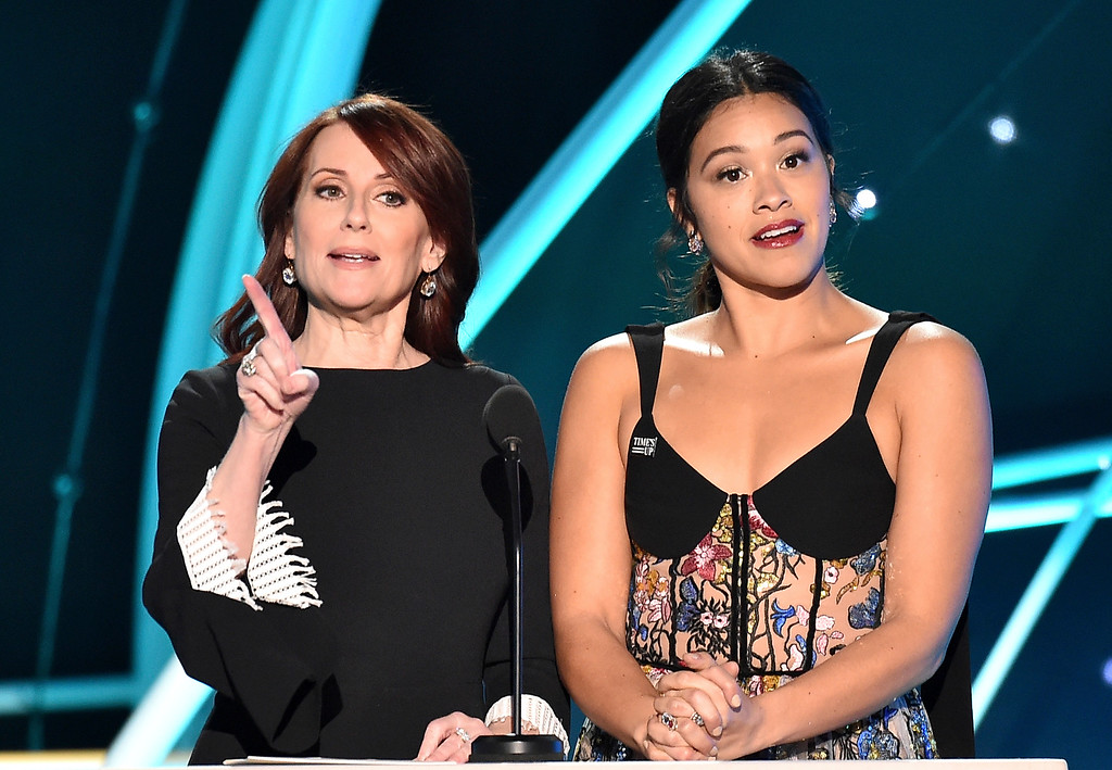 . Megan Mullally, left, and Gina Rodriguez present the award for outstanding performance by a male actor in a television movie or limited series at the 24th annual Screen Actors Guild Awards at the Shrine Auditorium & Expo Hall on Sunday, Jan. 21, 2018, in Los Angeles. (Photo by Vince Bucci/Invision/AP)