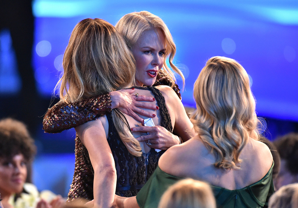 ". Laura Dern, left, and Reese Witherspoon, right, congratulate Nicole Kidman in the audience as she accepts the award for outstanding performance by a female actor in a television movie or limited series for ""Big Little Lies\"" at the 24th annual Screen Actors Guild Awards at the Shrine Auditorium & Expo Hall on Sunday, Jan. 21, 2018, in Los Angeles. (Photo by Vince Bucci/Invision/AP)"