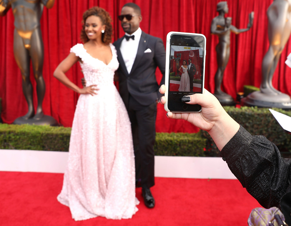 . A guest takes a photo of Sterling K. Brown, right, and Ryan Michelle Bathe at the 24th annual Screen Actors Guild Awards at the Shrine Auditorium & Expo Hall on Sunday, Jan. 21, 2018, in Los Angeles. (Photo by Matt Sayles/Invision/AP)