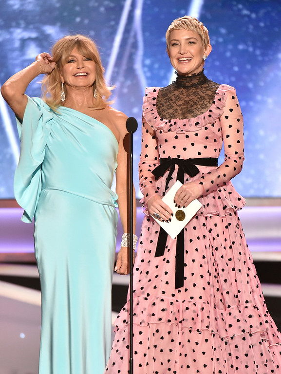 . Goldie Hawn, left, and Kate Hudson present the award for outstanding performance by an ensemble in a drama series at the 24th annual Screen Actors Guild Awards at the Shrine Auditorium & Expo Hall on Sunday, Jan. 21, 2018, in Los Angeles. (Photo by Vince Bucci/Invision/AP)