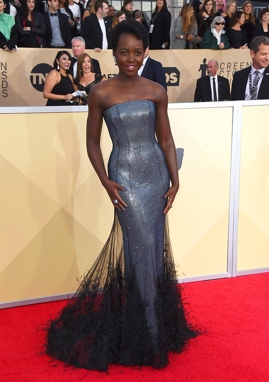 . Lupita Nyong\'o arrives at the 24th annual Screen Actors Guild Awards at the Shrine Auditorium & Expo Hall on Sunday, Jan. 21, 2018, in Los Angeles. (Photo by Jordan Strauss/Invision/AP)