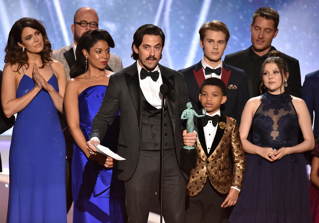 ". Milo Ventimiglia and the cast of ""This Is Us\"" accept the award for outstanding performance by an ensemble in a drama series at the 24th annual Screen Actors Guild Awards at the Shrine Auditorium & Expo Hall on Sunday, Jan. 21, 2018, in Los Angeles. (Photo by Vince Bucci/Invision/AP)"