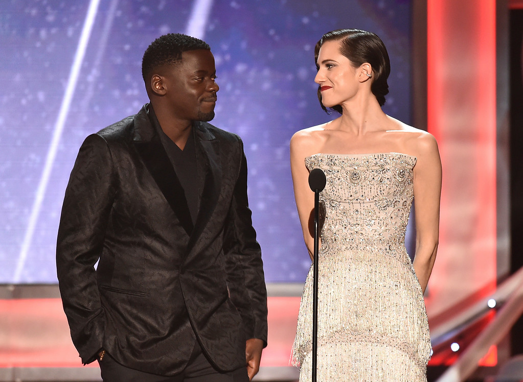 ". Daniel Kaluuya, left, and Allison Williams, nominees for outstanding performance by a cast in a motion picture for ""Get Out,\"" introduce a clip from their film at the 24th annual Screen Actors Guild Awards at the Shrine Auditorium & Expo Hall on Sunday, Jan. 21, 2018, in Los Angeles. (Photo by Vince Bucci/Invision/AP)"