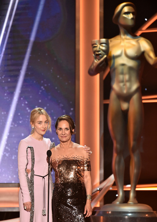 ". Saoirse Ronan, left, and Laurie Metcalf, nominees for outstanding performance by a cast in a motion picture for ""Lady Bird,\"" introduce a clip from their film at the 24th annual Screen Actors Guild Awards at the Shrine Auditorium & Expo Hall on Sunday, Jan. 21, 2018, in Los Angeles. (Photo by Vince Bucci/Invision/AP)"