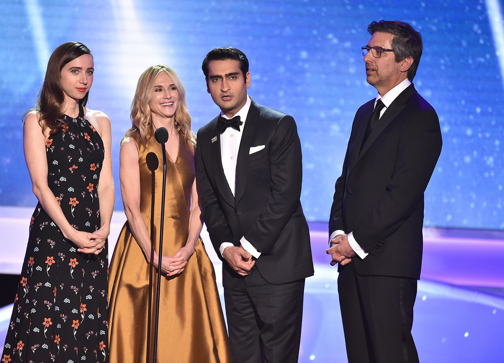 ". Zoe Kazan, from left, Holly Hunter, Kumail Nanjiani, and Ray Romano, nominees for outstanding performance by a cast in a motion picture for ""The Big Sick,\"" introduce a clip from their film at the 24th annual Screen Actors Guild Awards at the Shrine Auditorium & Expo Hall on Sunday, Jan. 21, 2018, in Los Angeles. (Photo by Vince Bucci/Invision/AP)"