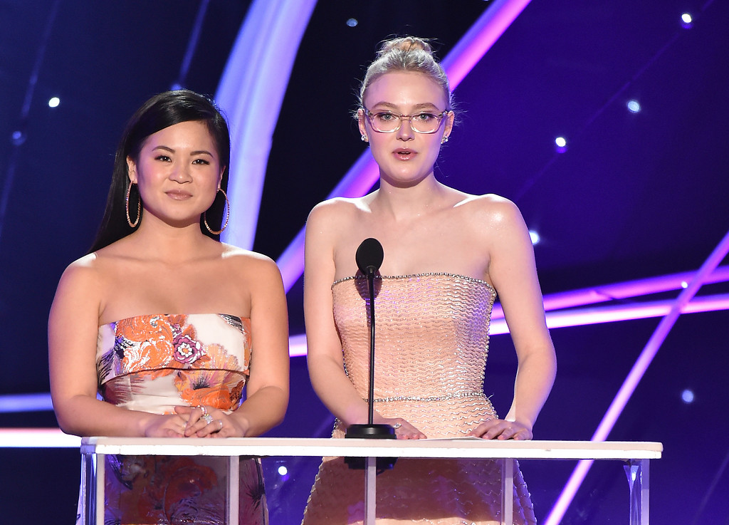 . Kelly Marie Tran, left, and Dakota Fanning present the award for outstanding performance by a female actor in a drama series at the 24th annual Screen Actors Guild Awards at the Shrine Auditorium & Expo Hall on Sunday, Jan. 21, 2018, in Los Angeles. (Photo by Vince Bucci/Invision/AP)