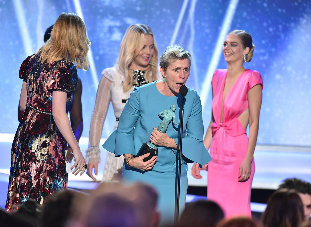 ". Frances McDormand and the cast of ""Three Billboards Outside Ebbing, Missouri\"" accept the award for outstanding performance by a cast in a motion picture at the 24th annual Screen Actors Guild Awards at the Shrine Auditorium & Expo Hall on Sunday, Jan. 21, 2018, in Los Angeles. (Photo by Vince Bucci/Invision/AP)"