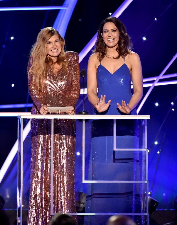 . Connie Britton, left, and Mandy Moore present the award for outstanding performance by a female actor in a comedy series at the 24th annual Screen Actors Guild Awards at the Shrine Auditorium & Expo Hall on Sunday, Jan. 21, 2018, in Los Angeles. (Photo by Vince Bucci/Invision/AP)