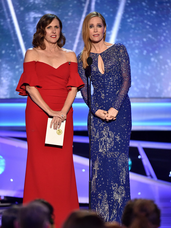 . Molly Shannon, left, and Leslie Mann present the award for outstanding ensemble in a comedy series at the 24th annual Screen Actors Guild Awards at the Shrine Auditorium & Expo Hall on Sunday, Jan. 21, 2018, in Los Angeles. (Photo by Vince Bucci/Invision/AP)