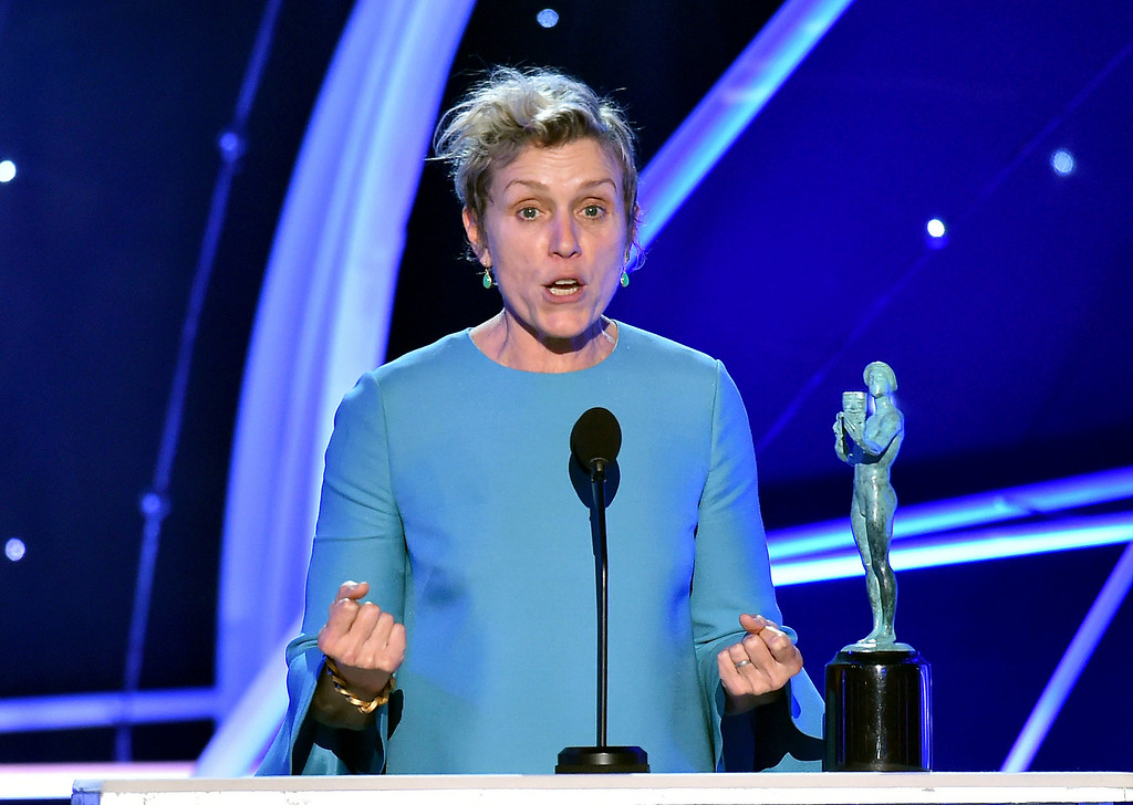 ". Frances McDormand accepts the award for outstanding performance by a female actor in a leading role for ""Three Billboards Outside Ebbing, Missouri\"" at the 24th annual Screen Actors Guild Awards at the Shrine Auditorium & Expo Hall on Sunday, Jan. 21, 2018, in Los Angeles. (Photo by Vince Bucci/Invision/AP)"