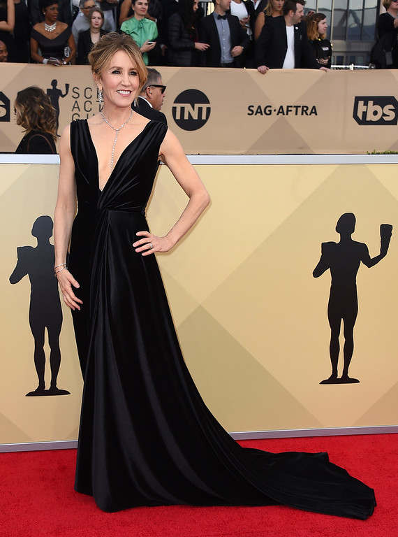 . Felicity Huffman arrives at the 24th annual Screen Actors Guild Awards at the Shrine Auditorium & Expo Hall on Sunday, Jan. 21, 2018, in Los Angeles. (Photo by Jordan Strauss/Invision/AP)