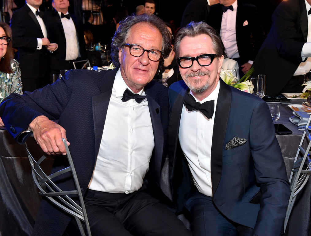 . Geoffrey Rush, left, and Gary Oldman appear in the audience at the 24th annual Screen Actors Guild Awards at the Shrine Auditorium & Expo Hall on Sunday, Jan. 21, 2018, in Los Angeles. (Photo by Vince Bucci/Invision/AP)