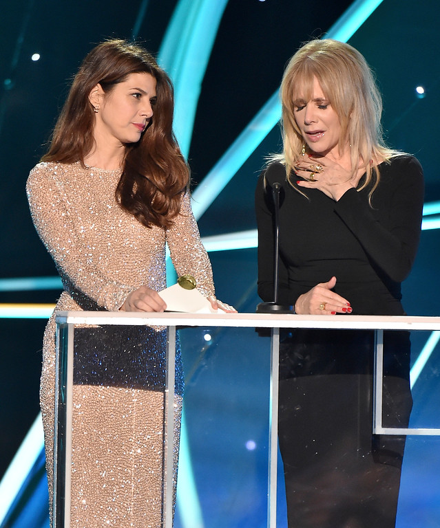 . Marisa Tomei, left, and Rosanna Arquette present the award for outstanding performance by a female actor in a television movie or limited series at the 24th annual Screen Actors Guild Awards at the Shrine Auditorium & Expo Hall on Sunday, Jan. 21, 2018, in Los Angeles. (Photo by Vince Bucci/Invision/AP)