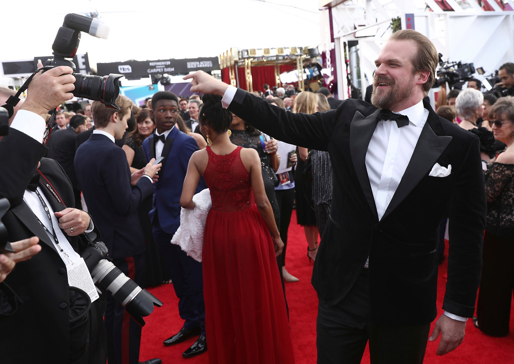 . David Harbour gestures to the crowd at the 24th annual Screen Actors Guild Awards at the Shrine Auditorium & Expo Hall on Sunday, Jan. 21, 2018, in Los Angeles. (Photo by Matt Sayles/Invision/AP)