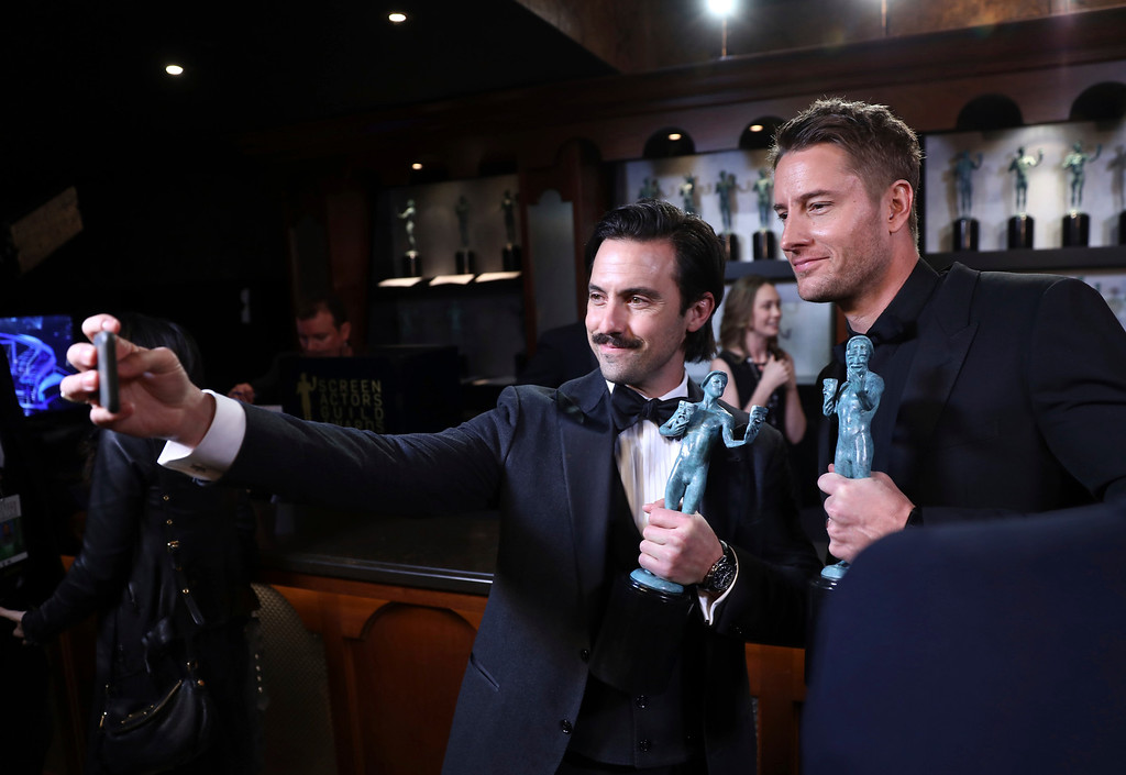 ". Milo Ventimiglia, left, and Justin Hartley pose with their awards for outstanding performance by an ensemble in a drama series for ""This Is Us\"" at the 24th annual Screen Actors Guild Awards at the Shrine Auditorium & Expo Hall on Sunday, Jan. 21, 2018, in Los Angeles. (Photo by Matt Sayles/Invision/AP)"