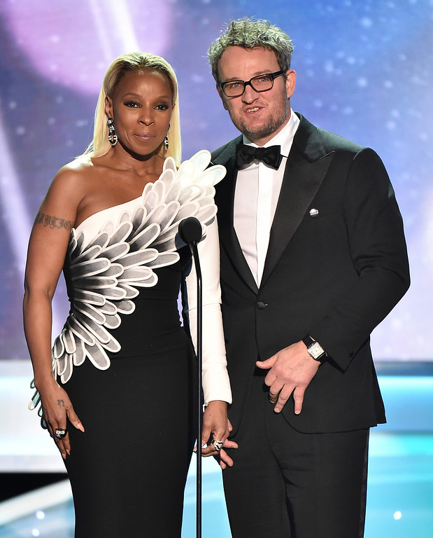 ". Mary J. Blige, left, and Jason Clarke, nominees for outstanding performance by a cast in a motion picture for ""Mudbound,\"" introduce a clip from their film at the 24th annual Screen Actors Guild Awards at the Shrine Auditorium & Expo Hall on Sunday, Jan. 21, 2018, in Los Angeles. (Photo by Vince Bucci/Invision/AP)"