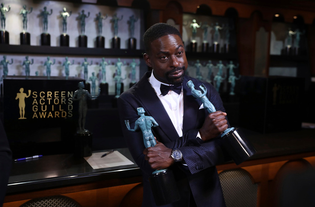 ". Sterling K. Brown poses with his awards for outstanding performance by a male actor in a drama series for ""This Is Us\"" and for outstanding performance by an ensemble in a drama series for \""This Is Us\"" backstage at the 24th annual Screen Actors Guild Awards at the Shrine Auditorium & Expo Hall on Sunday, Jan. 21, 2018, in Los Angeles. (Photo by Matt Sayles/Invision/AP)"
