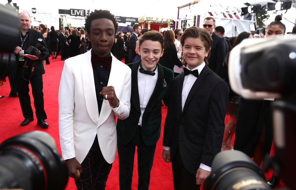 . Caleb McLaughlin, from left, Noah Schnapp, and Gaten Matarazzo arrive at the 24th annual Screen Actors Guild Awards at the Shrine Auditorium & Expo Hall on Sunday, Jan. 21, 2018, in Los Angeles. (Photo by Matt Sayles/Invision/AP)