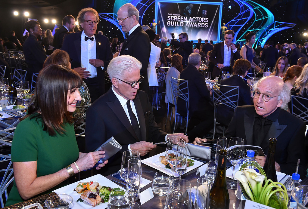 . Mary Steenburgen, from left, Ted Danson, and Larry David appear in the audience at the 24th annual Screen Actors Guild Awards at the Shrine Auditorium & Expo Hall on Sunday, Jan. 21, 2018, in Los Angeles. Geoffrey Rush, left, and Gary Oldman, right, appear in back. (Photo by Vince Bucci/Invision/AP)