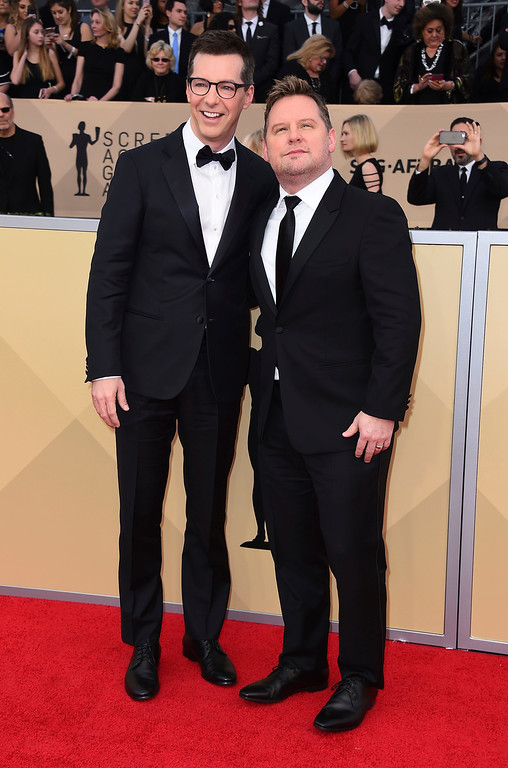 . Sean Hayes, left, and Scott Icenogle arrive at the 24th annual Screen Actors Guild Awards at the Shrine Auditorium & Expo Hall on Sunday, Jan. 21, 2018, in Los Angeles. (Photo by Jordan Strauss/Invision/AP)