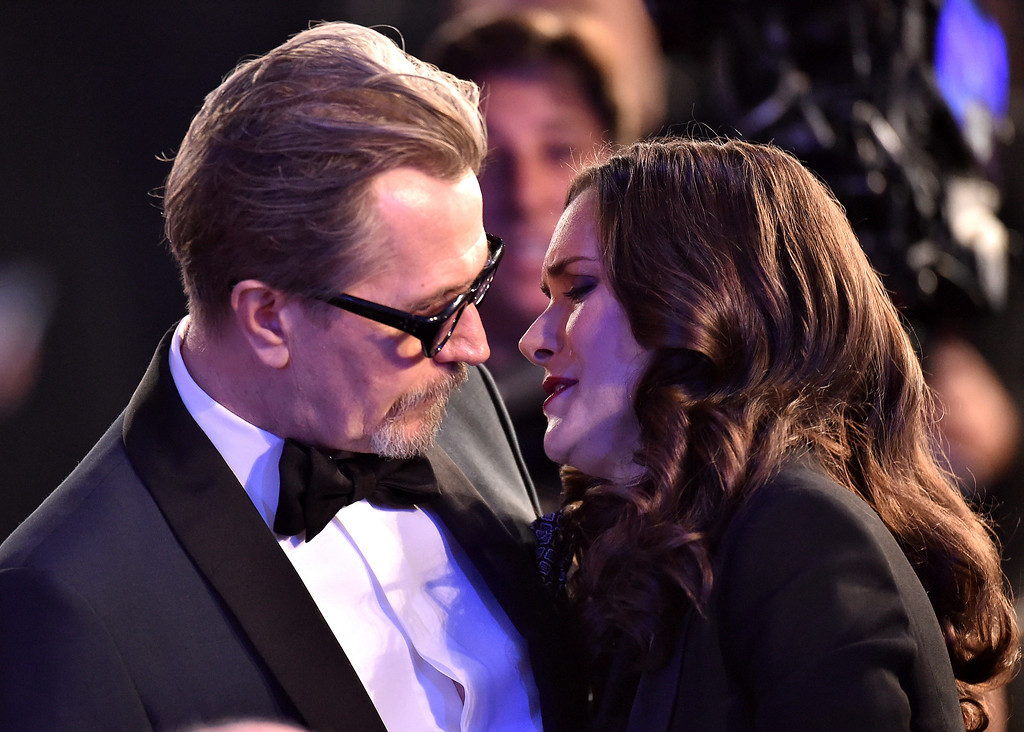 . Gary Oldman, left, and Winona Ryder speak in the audience at the 24th annual Screen Actors Guild Awards at the Shrine Auditorium & Expo Hall on Sunday, Jan. 21, 2018, in Los Angeles. (Photo by Vince Bucci/Invision/AP)