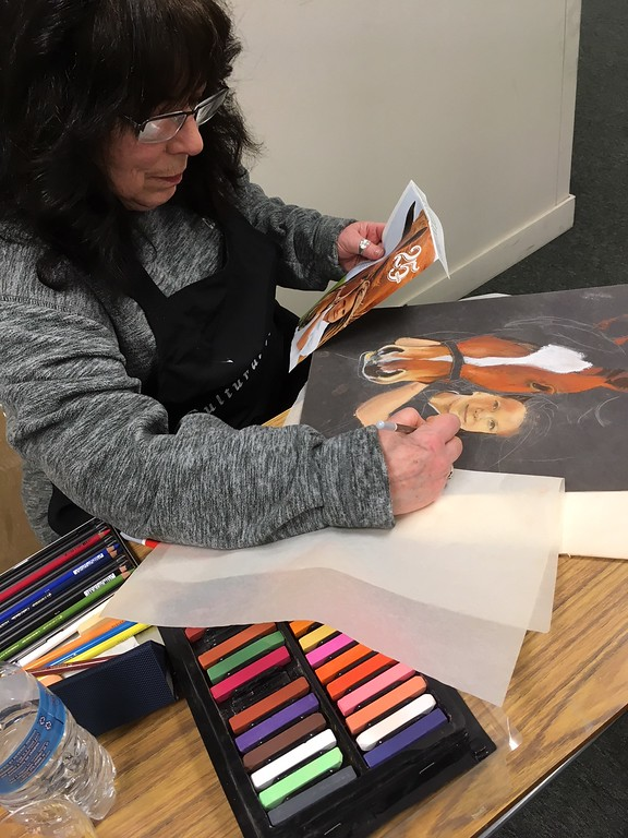 . Richard Payerchin - The Morning Journal <br> Artist Virginia Sonntag of Avon Lake creates a new portrait at TrueNorth Cultural Arts\' new artistic center at 739-1 Moore Road, Avon Lake. Arts enthusiasts packed the open house on Jan. 20, 2018, to celebrate the opening and tour the new center.