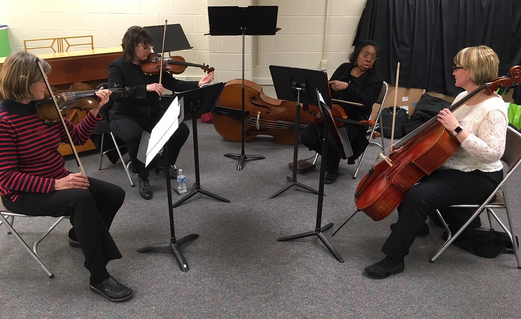 . Richard Payerchin - The Morning Journal <br> A string quartet warms up to play during the grand opening of TrueNorth Cultural Arts\' new artistic center at 739-1 Moore Road, Avon Lake. Arts enthusiasts packed the open house on Jan. 20, 2018, to celebrate the opening and tour the new center.