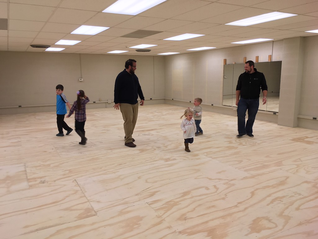 . Richard Payerchin - The Morning Journal <br> Children and adults alike enjoy the wood base that will sit underneath the new dance floor to be installed at TrueNorth Cultural Arts\' new artistic center at 739-1 Moore Road, Avon Lake. Arts enthusiasts packed the open house on Jan. 20, 2018, to celebrate the opening and tour the new center.