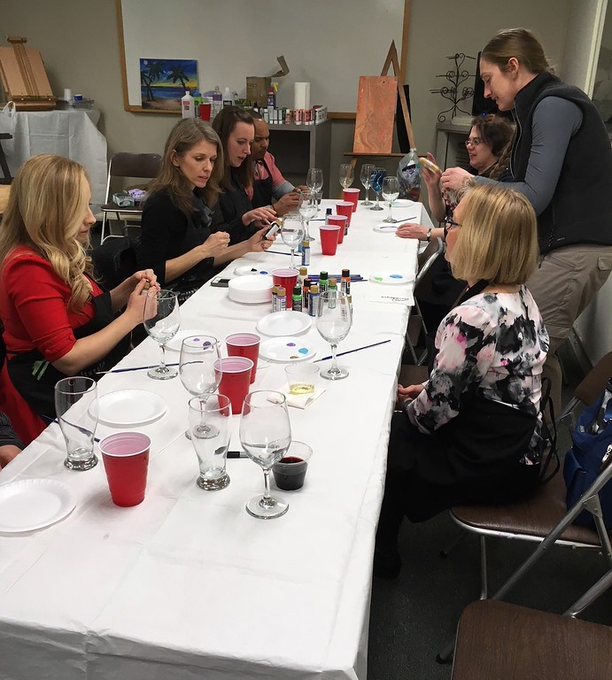 . Richard Payerchin - The Morning Journal <br> A group of arts enthusiasts get ready to paint their own wine glasses during the grand opening of TrueNorth Cultural Arts\' new artistic center at 739-1 Moore Road, Avon Lake. Arts enthusiasts packed the open house on Jan. 20, 2018, to celebrate the opening and tour the new center.