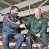 Rick LeMaster, equine specialist at Lake Metroparks Farmpark hands the reins over to Frank Soltysiak of Cleveland to drive the parks show wagon around the arena after participating in LeMaster's from Harness to Hitch program. (Kristi Garabrandt/The News-Herald).