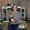 "Rebecca Gengler, owner of More Polish Pottery LLC, holds her 9-week-old Goldendoodle puppy named Bear while standing in the new showroom of her shop. More Polish Pottery, located at 8S953 Jericho Road in Big Rock, will celebrate its ""re-grand opening"" from Jan. 24 to 31with open house-style events, including presentations, food, tours and special deals."