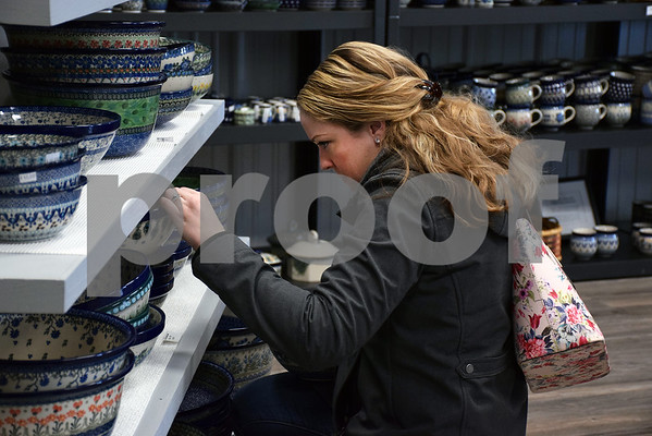 On Tuesday, Jan. 16, Hannah Riessen of Lockport tries to decide which bowl of Polish pottery to purchase during her first time shopping at More Polish Pottery, LLC, 8s953 Jericho Road in Big Rock.
