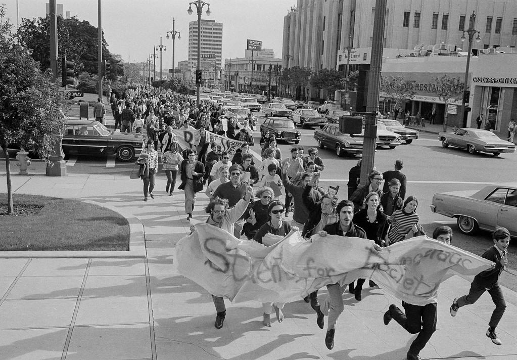 . Several hundred people affiliated with the SDS (Students for a Democratic Society) race through the Los Angeles Civic Center en route from the Federal Building to the County Courthouse in a demonstration against the Vietnam war, Jan. 12, 1968. After a rally at the courthouse, they marched 11 blocks to an induction center for another rally before disbanding.  (AP Photo/Harold Filan)