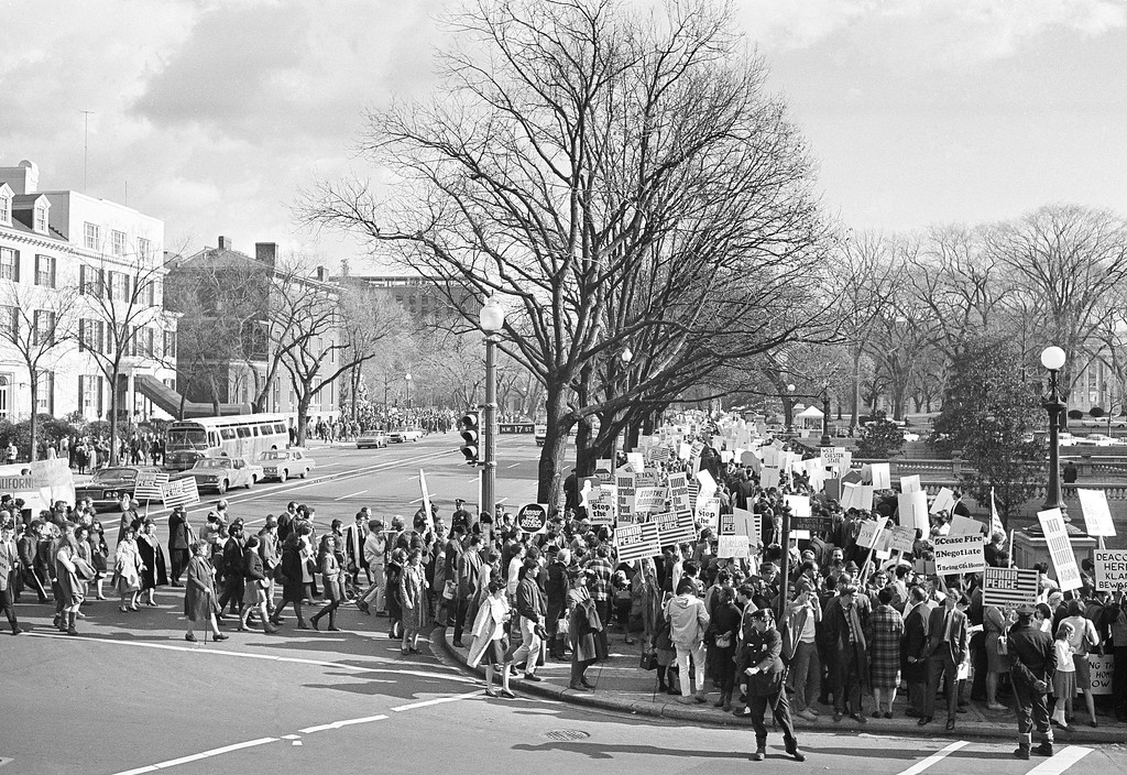 . Peace marchers by the thousands march for blocks along Pennsylvania Avenue in Washington on Nov. 27, 1965. The White House, focal point of the �For peace in Vietnam� demonstration, is at upper right. This view is from the intersection of 17th Street, foreground and Pennsylvania Avenue. (AP Photo)