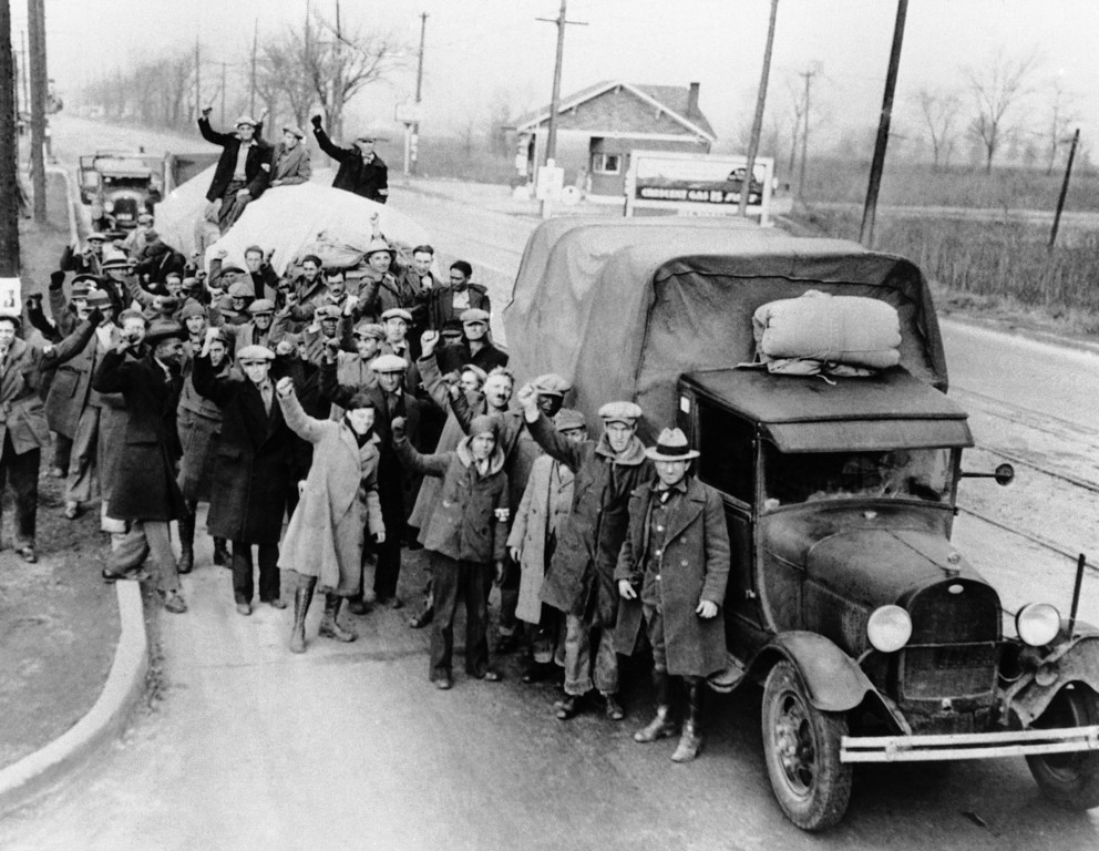 . Crowded into 5 trucks and 12 automobiles, about 125 hunger marchers and 25 Bonus Army Veterans prepare to leave St. Louis for Washington, D.C., Nov. 29, 1932, to demonstrate for unemployment relief and prompt payment of the bonus. Here is a group of the marchers before the start. (AP Photo)