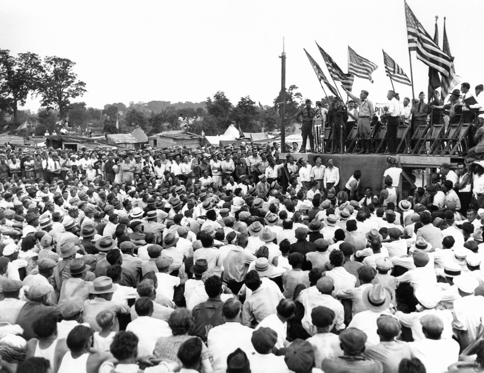 """. Major General Smedley D. Butler, retired, exhorts the veterans in Washington to stay until the bonus was been paid, July 19, 1932. His speech was greeted with wild applause. He concluded by saying \""""I went on the retired list last October and this is the first time I have felt at home since.\"""" (AP Photo)"""