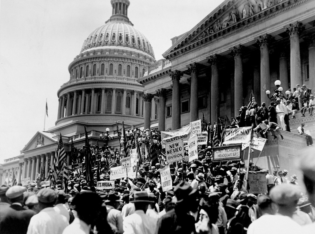 . The bedraggled Bonus Army, made up of war veterans, gathers on the steps of the Capitol in Washington, D.C., after a long march down Pennsylvania Avenue, July 5, 1932. They heard their speakers demand again relief for the former soldiers, and then quietly dispersed. Nearly 5,000 men took part in the trek to the Capitol. (AP Photo)