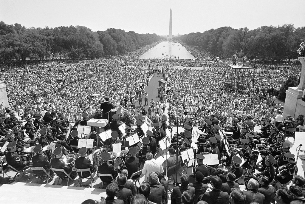 . This is a general view of musicians and the huge crowd that turned out in Washington, July 4, 1970 as the Rev. Billy Graham speaks from the Lincoln Memorial. Graham was the featured speaker in opening event on the religious and patriotic program on Honor America Day. In the background is the Mall and the Washington Monument.  (AP Photo)