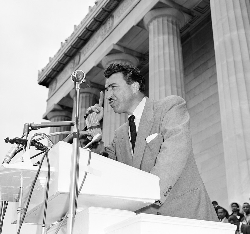 """. Adam Clayton Powell Jr. (D-NY) addresses \""""Prayer Pilgrimage for Freedom\"""" at the Lincoln Memorial in Washington, D.C., May 17, 1957. (AP Photo/Charles Gorry)"""