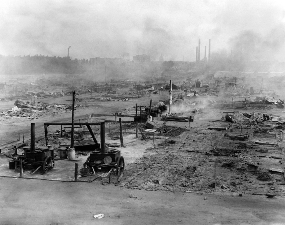 . The smoldering ruins of camp Antacostia after it had been cleared by government troops in Washington, July 29, 1932. The bonus army, scattered widely over the countryside, later returned to these scenes in scattered groups in an effort to salvage some of their belongings. (AP Photo)