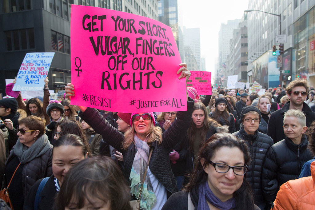 . Demonstrators march up 5th Avenue during a women\'s march, Saturday, Jan. 21, 2017, in New York. The march is being held in solidarity with similar events taking place in Washington and around the nation. (AP Photo/Mary Altaffer)