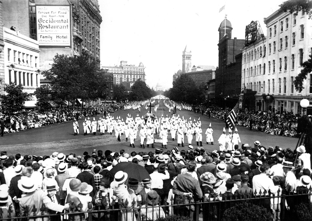 . The Ku Klux Klan marches down Pennsylvania Ave. past the Treasury Building in Washington D.C. in 1925.  (AP Photo)