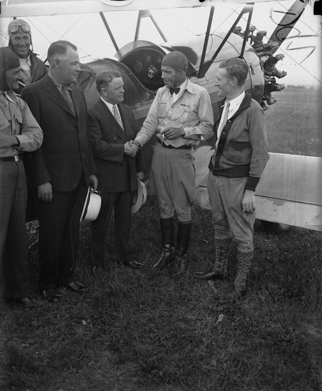 """. Walter Waters, right, commander-in-chief of the Bonus Expeditionary Force, is greeted by Mayor Eddie McCloskey upon his arrival by plane from Washington, D.C., in Johnstown, Pa., July 31, 1932. Waters was there to visit several thousand of his Bonus Army followers encamped on a hill outside the city. Waters, whose tidings of a refuge for the veterans in a Maryland \""""colony\"""" was roundly cheered, called for a nation-wide organization of \""""khaki shirts,\"""" a paramilitary political unit. (AP Photo)"""