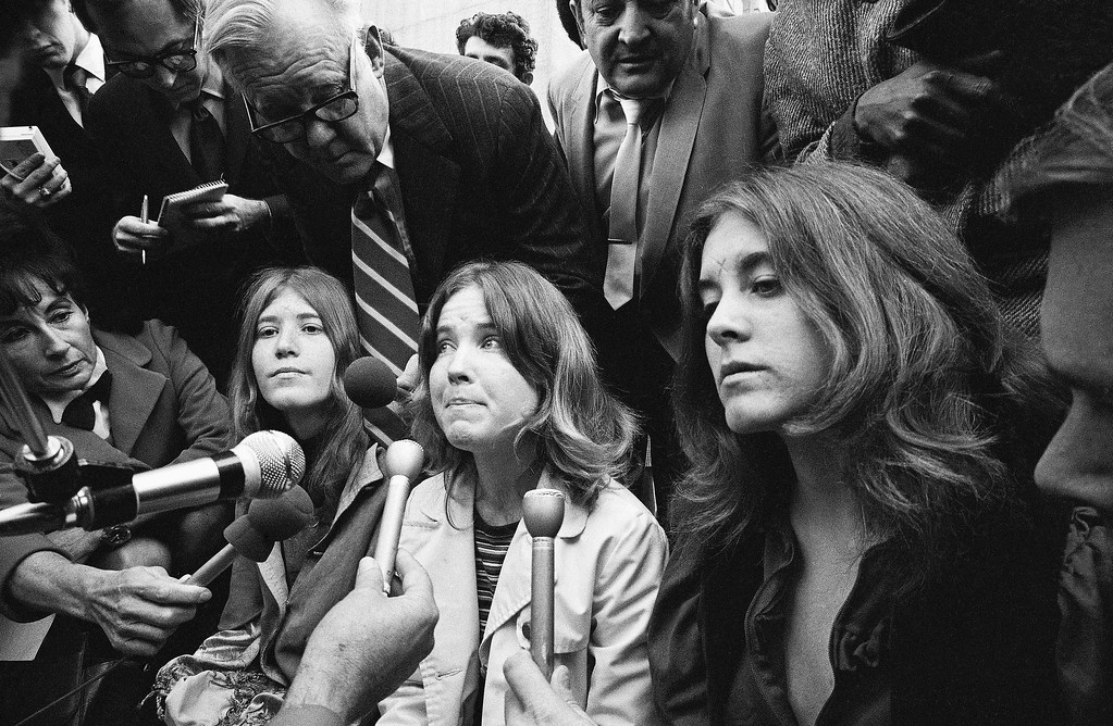 ". Some of the Manson ""family\'s"" cult members are shown, Jan. 26, 1971 in Los Angeles, Calif., as they heard from newsmen that Charles Manson and three female defendants had been found guilty of murder. Left to right: Kitty Lutesinger, Catherine ""Cappy"" Gillies and Nancy ""Brenda"" Pitman.(AP Photo/George Brich)"